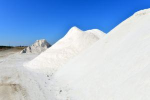 Large piles of borax stored near an agricultural chemical plant resemble snowy mountains.