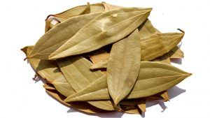 Dry bay leaves on white background.