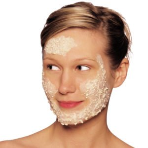 Beautiful girl exfoliate on face