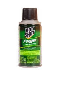 A green can of hot shot fogger with odor neutralizer on white background.