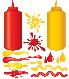 Bottles of hot sauce spray on white background.