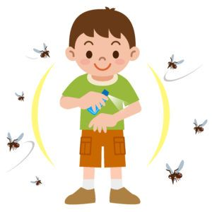 A boy is spraying mosquito repellent on his arm and several mosquitoes flying around him.
