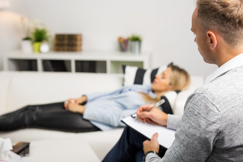 Man lying in doctor's office doing Hypnotherapy