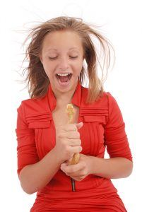 Girl holding a snake and screaming