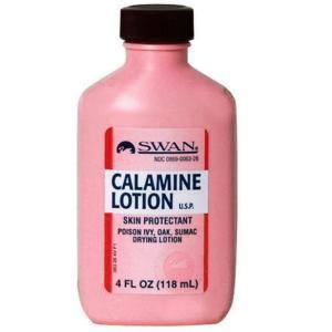 A bottle of calmine lotion on the white.