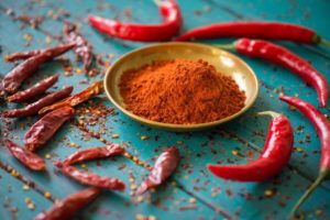 Cayenne pepper on blue table