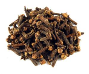 Whole ceylon cloves on white background