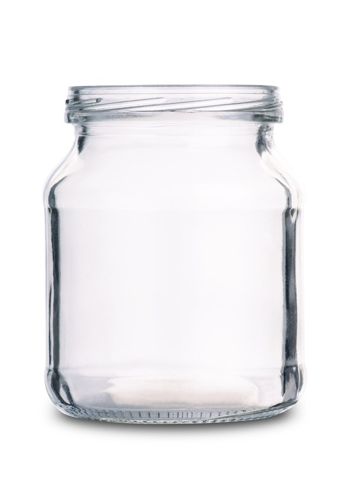 Empty glass jar isolated on a white background.