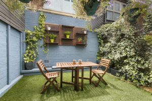 Clear back yard with outdoor seating
