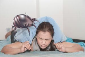 Woman allergic to dust mites on the bed.