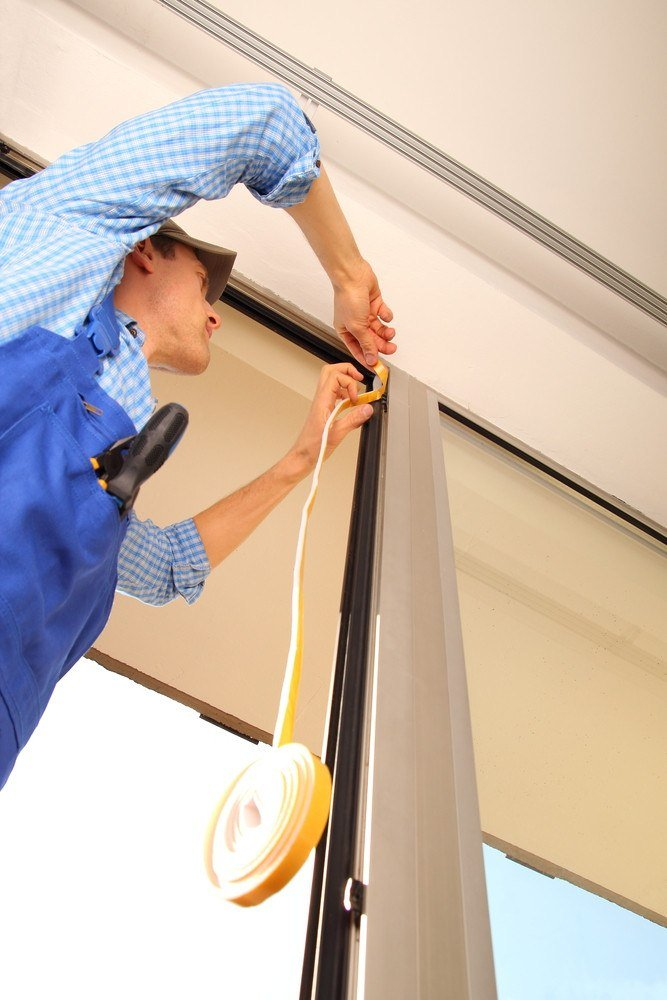 Professional sealing a window frame.